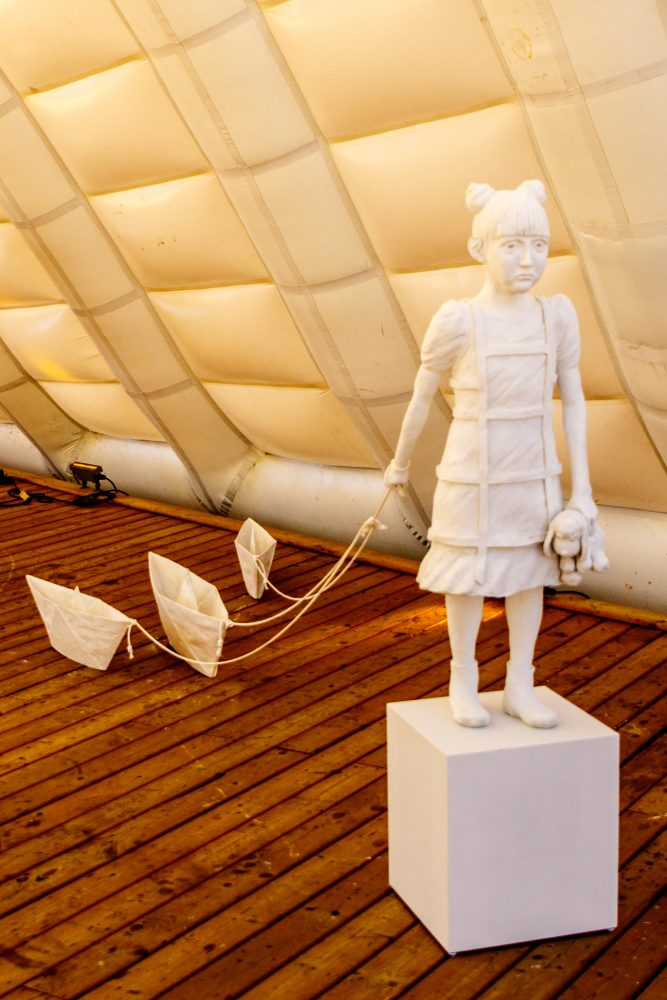 """The Girl with Paper Boats"" by W.W. Hung ( Photo Cr. Frank Wood."