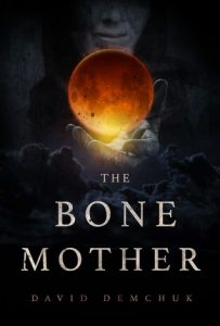 Image Description: Book cover for The Bone Mother by David Demchuk. It has the image of an orange orb floating above the hand of a figure with an obscured face among dark clouds.
