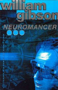 Image Description: The book cover for Neuromancer by William Gibson. It is black and blue with the face of a person wearing a mechanical visor super imposed over metal structures.