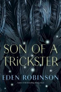 Image Description: Book cover for Son of a Trickster by Eden Robinson. The book title and author name are on top of a background of dark gray and blue feathers with what looks like possibly snow falling in front of them.
