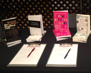 The four Book Club books on a table
