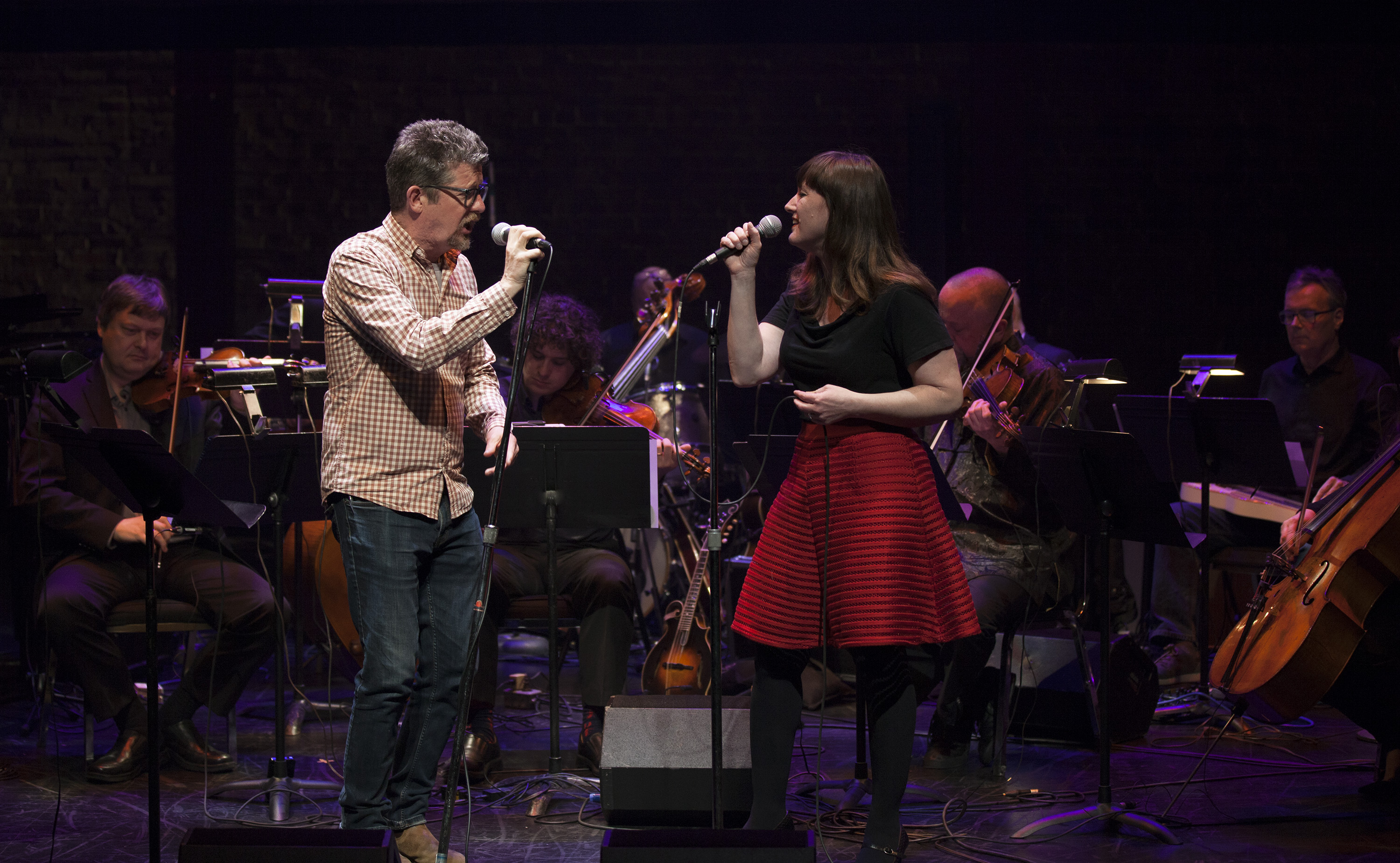 Singers Andy Maize and Suzie Ungerlieder sing in Art of Time Ensemble's Doghouse Roses: The Words and Music of Steve Earle.